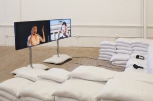 "Bildsujet Ausstellung krieg kuratieren: Installation von Hito Steyerl, ""Is the Museum a Battlefield?"", 2013 (Two channel digital video, sound, Artists Space, New York)"